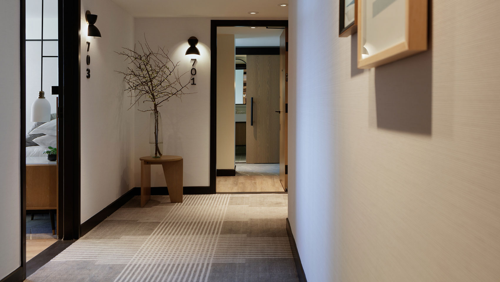 guestroom hallways with wood doors and black accents