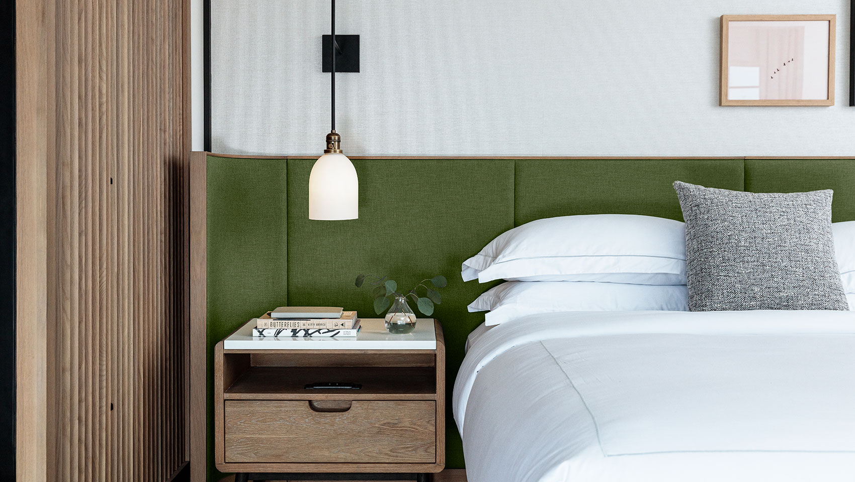 king bed guestroom with nightstand