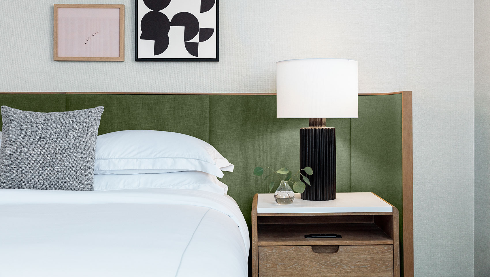 king bed guestroom with green headboard